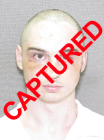 Photo of apprehended escapee David R. Puckett